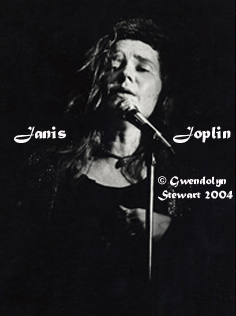Photograph  of JANIS JOPLIN in the Spotlight at her Harvard Stadium Concert, by GWENDOLYN  STEWART c. 2009; All Rights Reserved
