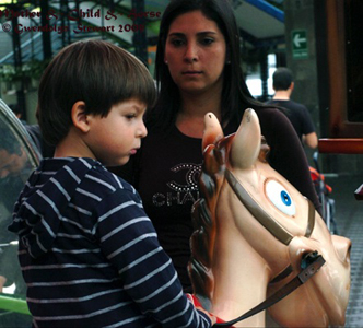 Photograph of MOTHER &  SON & 'HORSE' in Lima, Peru, by GWENDOLYN STEWART, c. 2013; All Rights Reserved
