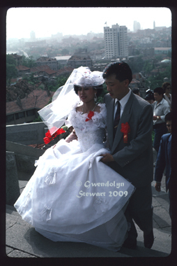 Bride and  Groom, The Bell Tower, Qingdao, China, 1994, Photographed by Gwendolyn  Stewart c. 2009; All Rights Reserved