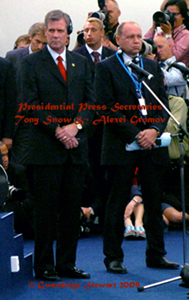 Photograph of presidential press secretaries Tony Snow and Andrei  Gromov at the 2006 G-8 Summit in St. Petersburg, Russia, by Gwendolyn Stewart,  c. 2010; All Rights Reserved